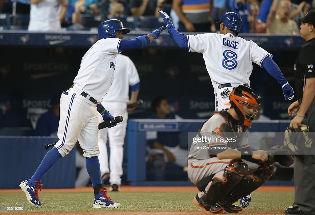 Anthony Gose #8 of the Toronto Blue Jays is congratulated by Jose Reyes #7 after hitting a solo home run in the fifth inning during MLB game action against the Baltimore Orioles on August 7, 2014 at Rogers Centre in Toronto, Ontario, Canada.