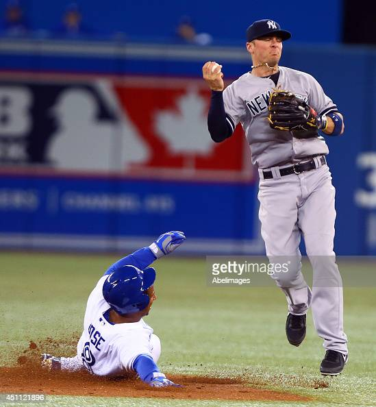 Anthony Gose of the Toronto Blue Jays is out at second as Brendan Ryan of the New York Yankees failed to make the double play during MLB action at...