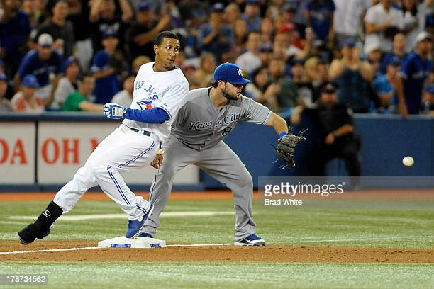 Anthony Gose of the Toronto Blue Jays is safe at third base after hitting a stand up triple as Mike Moustakas of the Kansas City Royals covers the...