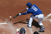 Anthony Gose of the Toronto Blue Jays lays down a sacrifice bunt in the second inning during MLB game action against the Boston Red Sox on July 24...
