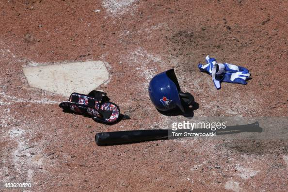 Anthony Gose of the Toronto Blue Jays leaves his bat and helmet and batting gloves and shin guard at home plate after striking out to end the seventh...