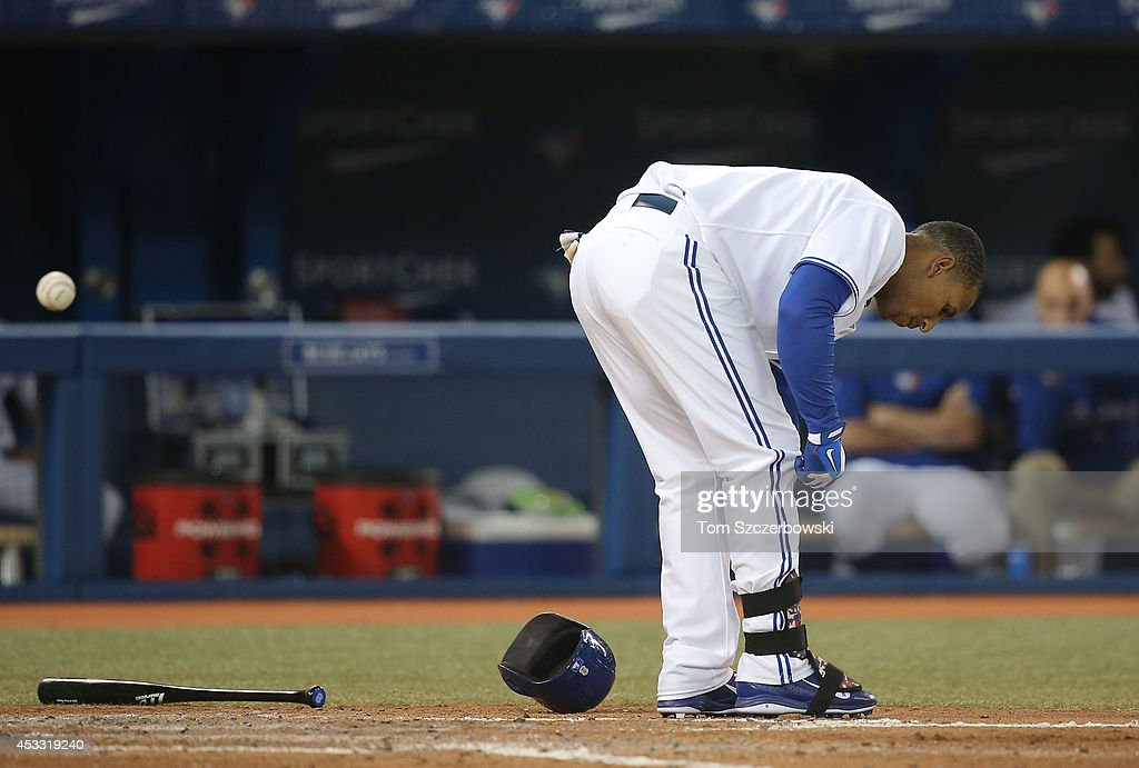 Anthony Gose #8 of the Toronto Blue Jays reacts after striking out to end the seventh inning during MLB game action against the Baltimore Orioles on August 7, 2014 at Rogers Centre in Toronto, Ontario, Canada.