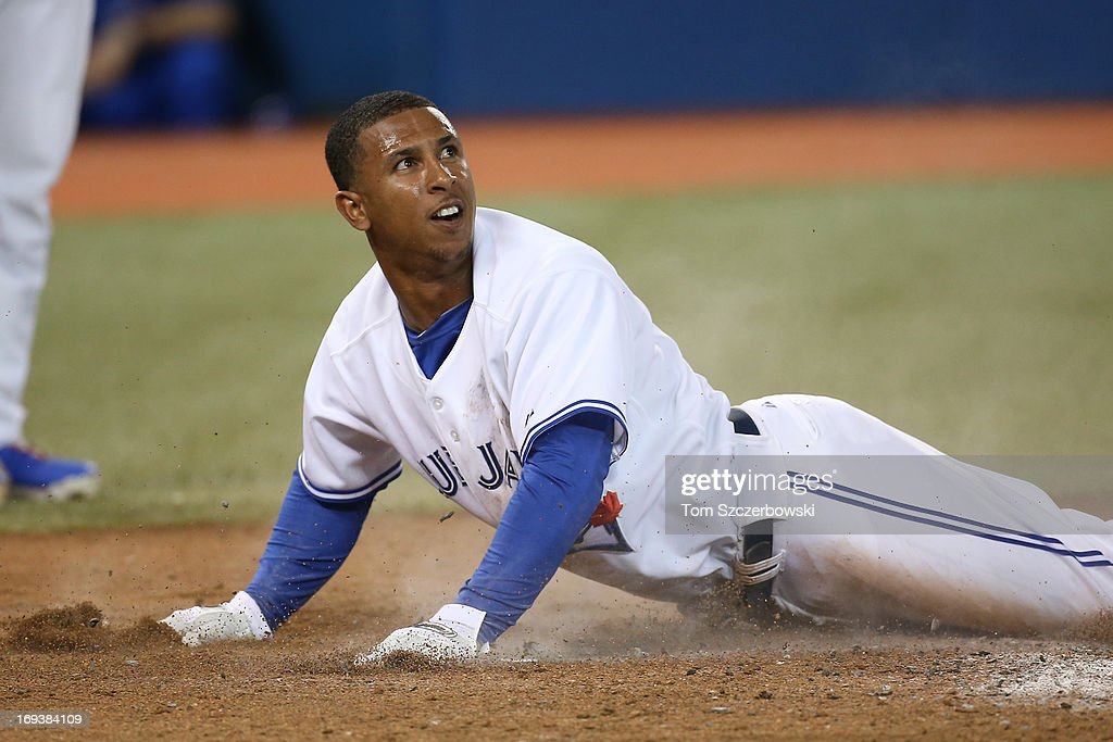 Anthony Gose #8 of the Toronto Blue Jays slides across home plate safely in the eighth inning during MLB game action against the Baltimore Orioles on May 23, 2013 at Rogers Centre in Toronto, Ontario, Canada.