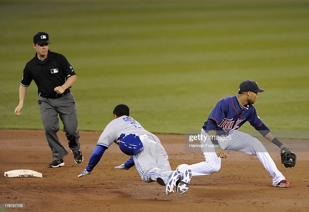 Anthony Gose #8 of the Toronto Blue Jays slides into second base safely as Pedro Florimon #25 of the Minnesota Twins fields the ball during the third inning of the game on September 6, 2013 at Target Field in Minneapolis, Minnesota.