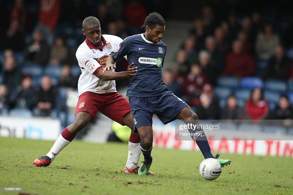 Anthony Grant of Southend United controls the ball under pressure from Nathaniel Wedderburn of Northampton Town during the npower League Two match between Southend United and Northampton Town at Roots Hall on February 26, 2011 in Southend, England.