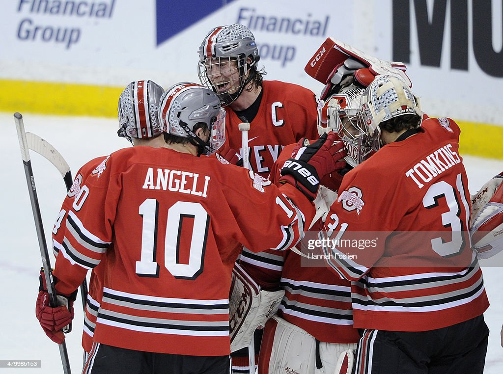 Anthony Greco #14, Darik Angeli #10, Curtis Gedig #8, Christian Frey #30 and Matt Tomkins #31 of the Ohio State Buckeyes celebrate a win of the semifinal game of the Big Ten Men's Ice Hockey Championship against the Minnesota Golden Gophers on March 21, 2014 at Xcel Energy Center in St Paul, Minnesota. The Ohio State Buckeyes defeated the Minnesota Golden Gophers 3-1.