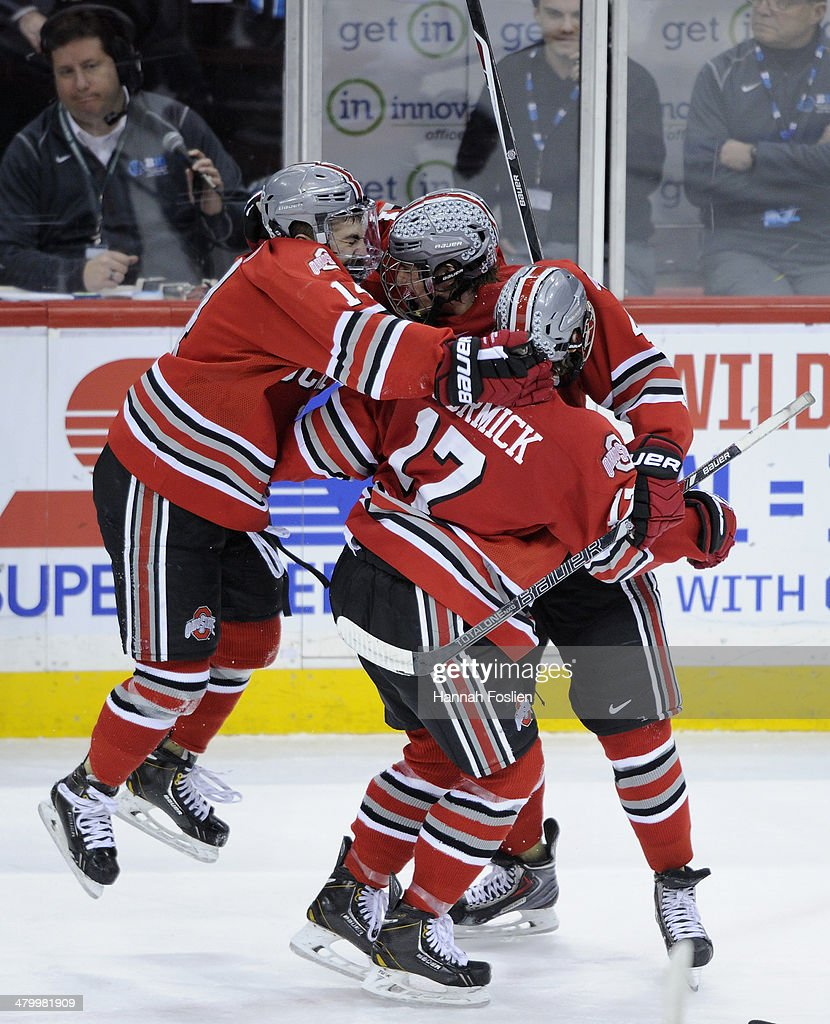 Anthony Greco #14, Drew Brevig #4 and Max McCormick #17 of the Ohio State Buckeyes celebrate an empty net goal against the Minnesota Golden Gophers by Greco during the third period of the semifinal game of the Big Ten Men's Ice Hockey Championship on March 21, 2014 at Xcel Energy Center in St Paul, Minnesota. The Ohio State Buckeyes defeated the Minnesota Golden Gophers 3-1.
