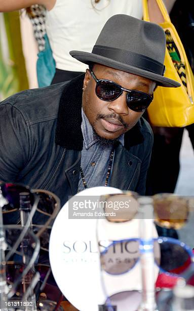 Anthony Hamilton in Carrera Pocket Flag 3/S sunglasses poses with SOLSTICE Sunglasses and Safilo USA during the 55th Annual GRAMMY Awards at the...