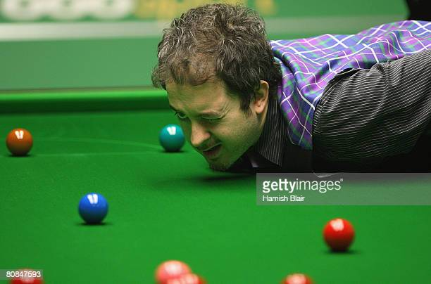 Anthony Hamilton of England lines up a shot during his match against Stephen Maguire of Scotland during day six of the 888com World Snooker...