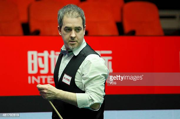 Anthony Hamilton of England looks on during the match against Neil Robertson of Australia on day one of the 2014 World Snooker China Open at Beijing...