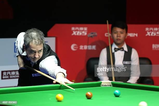 Anthony Hamilton of England plays a shot against Zhou Yuelong of China during day two of the 2015 World Snooker China Open at Peking University...