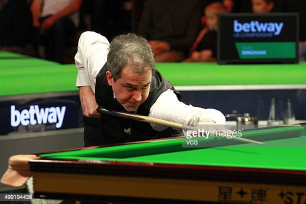 Anthony Hamilton of England plays a shot during a match against Stuart Bingham of England in their second round matches on day four of Betway UK...