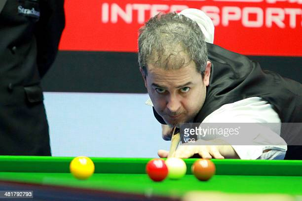 Anthony Hamilton of England plays a shot during the match against Neil Robertson of Australia on day one of the 2014 World Snooker China Open at...