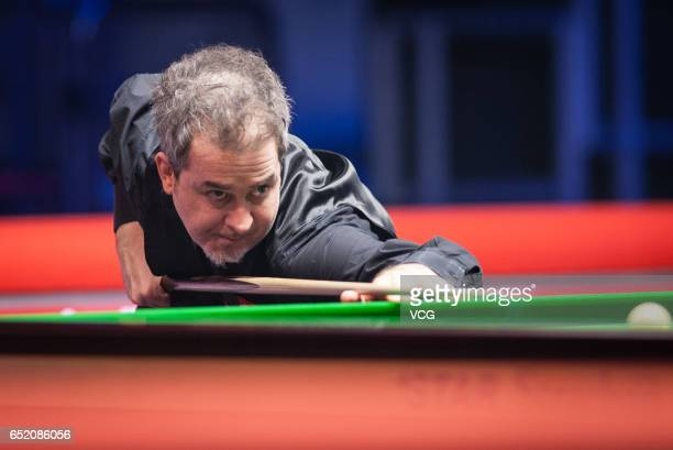Anthony Hamilton of England plays a shot during the semifinal match against Ding Junhui of China on day five of 2017 Ladbrokes Players Championship...