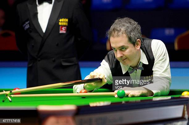 Anthony Hamilton of England reacts against Mark Selby of England on Day one of the 2014 Snooker Haikou World Open on March 10 in Haikou Hainan China