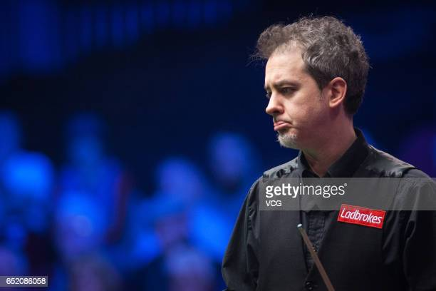 Anthony Hamilton of England reacts during the semifinal match against Ding Junhui of China on day five of 2017 Ladbrokes Players Championship at...