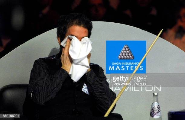 Anthony Hamilton wipes his face during his defeat to China's Ding Junhui