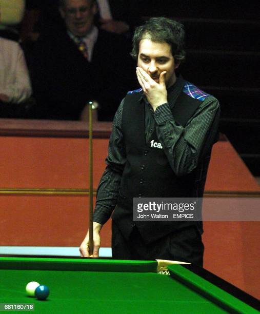 Anthony Hamiltonv ponders on how to escape a snooker from Stephen Hendry in the final frame of the day