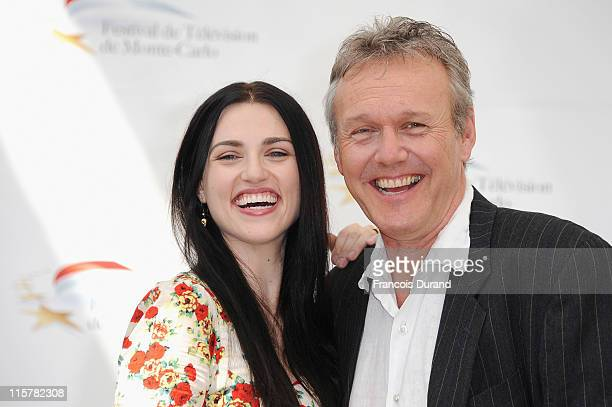 Anthony Head and Katie McGrath pose during a photocall for the TV show 'The Adventures Of Merlin' during the 2011 Monte Carlo Television Festival...