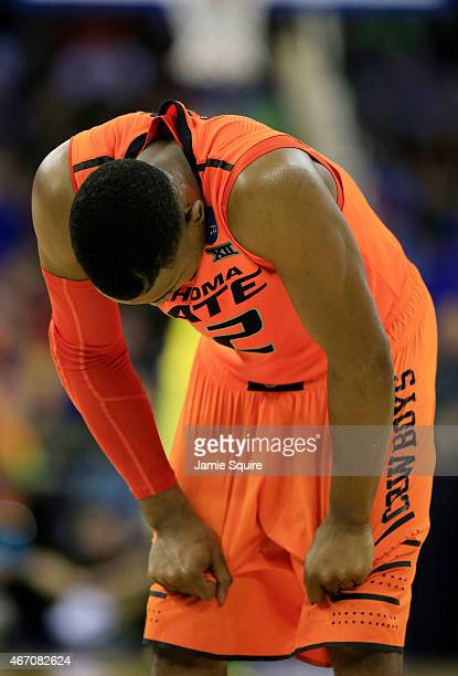 Anthony Hickey Jr #12 of the Oklahoma State Cowboys reacts to their 79 to 73 loss to the Oregon Ducks during the second round of the 2015 NCAA Men's...