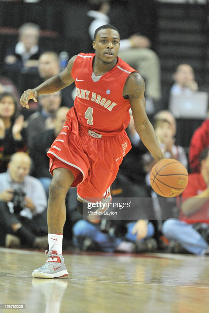 Anthony Jackson #4 of the Stony Brook Seawolves dribbles the ball up court during a college basketball game against the Maryland Terrapins on December 21, 2012 at the Comcast Center in College Park, Maryland. The Terrapins won 76-69.