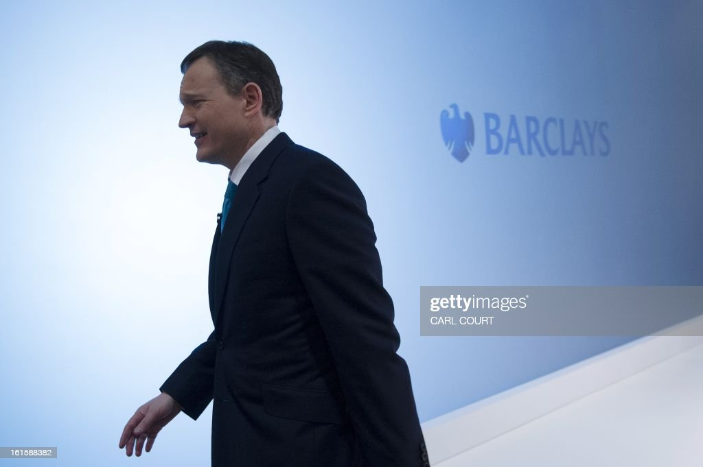Anthony Jenkins, Group Chief Executive of Barclays bank, leaves after posing for photographers during an interval in a media conference in central London on February 12, 2013. Barclays will cut at least 3,700 jobs this year and slash costs, the scandal-hit bank announced on February 12, 2013 as it also revealed that it had plunged into an annual net loss amid the Libor rate-rigging crisis. The British bank said in a statement that it would 'reduce headcount by at least 3,700 across the group, including 1,800 in the Corporate & Investment Bank and 1,900 in Europe Retail and Business Banking.' Barclays employs 140,000 staff.