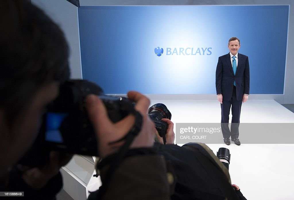 Anthony Jenkins, Group Chief Executive of Barclays bank, poses for photographers during an interval in a media conference in central London on February 12, 2013. Barclays will cut at least 3,700 jobs this year and slash costs, the scandal-hit bank announced on February 12, 2013 as it also revealed that it had plunged into an annual net loss amid the Libor rate-rigging crisis. The British bank said in a statement that it would 'reduce headcount by at least 3,700 across the group, including 1,800 in the Corporate & Investment Bank and 1,900 in Europe Retail and Business Banking.' Barclays employs 140,000 staff.AFP PHOTO/CARL COURT