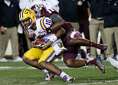 Anthony Jennings of the LSU Tigers gets sacked by Devonta Burns of the Texas AM Aggies during the second half of their game at Kyle Field on November...