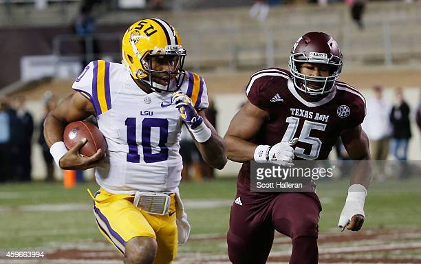 Anthony Jennings of the LSU Tigers runs away from Myles Garrett of the Texas AM Aggies in the first half of their game at Kyle Field on November 27...