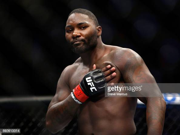 Anthony Johnson celebrates his firstround knockout win over Glover Teixeira in their light heavyweight bout at the UFC 202 event at TMobile Arena on...