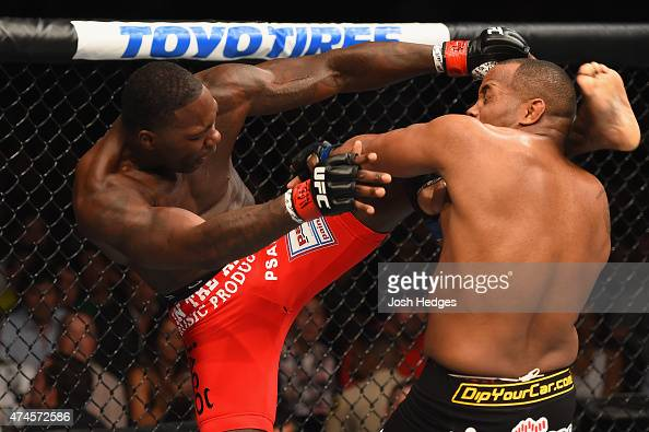 Anthony Johnson kicks Daniel Cormier in their UFC light heavyweight championship bout during the UFC 187 event at the MGM Grand Garden Arena on May...