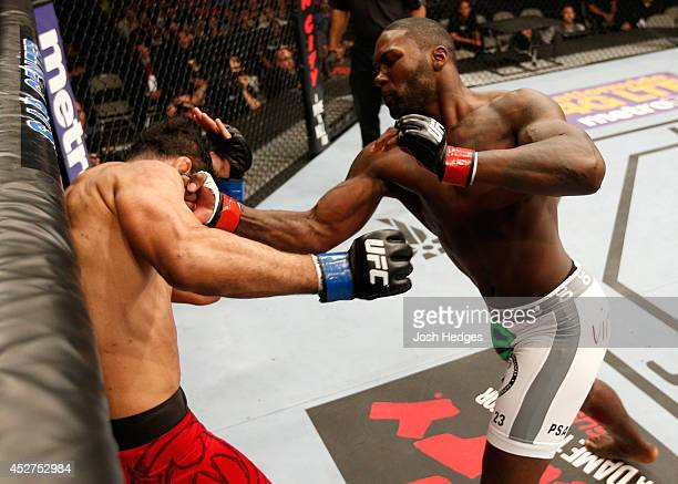 Anthony Johnson knocks out Antonio Rogerio Nogueira with a series of uppercuts in their light heavyweight bout during the UFC Fight Night event at...