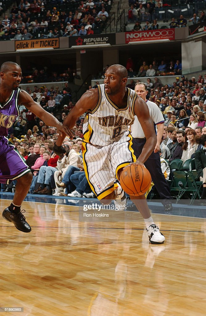 milwaukee to indianapolis. anthony johnson #8 of the indiana pacers drives around mike james #13 milwaukee to indianapolis i