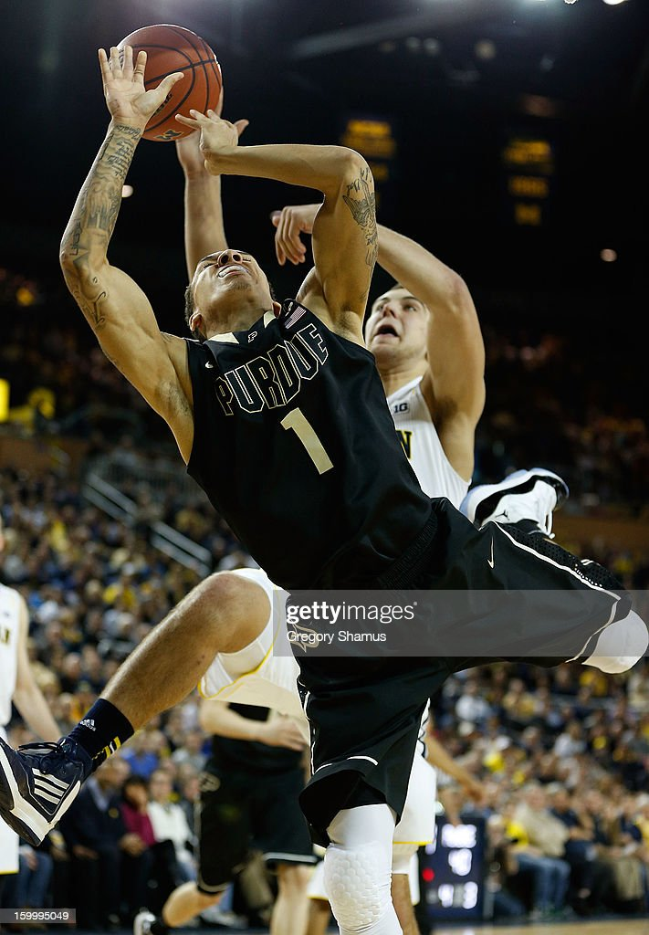 Anthony Johnson #1 of the Purdue Boilermakers gets a second half shot blocked by Mitch McGary #4 of the Michigan Wolverines at Crisler Center on January 24, 2013 in Ann Arbor, Michigan. Michigan won the game 68-53.