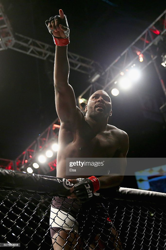 Anthony Johnson of the United States celebrates his win by TKO against Ryan Bader (not pictured) of the United States in the first round of their light heavyweight bout during the UFC Fight Night event at the Prudential Center on January 30, 2016 in Newark, New Jersey.