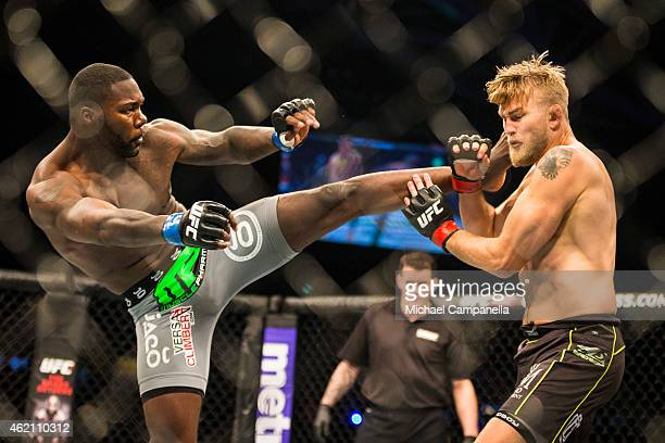 Anthony Johnson of the United States lands a kick on Alexander Gustafsson of Sweden during the UFC Fight Night event at Tele2 Arena on January 24...