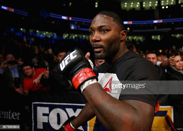 Anthony Johnson of the United States leaves the Octagon after his win by TKO against Ryan Bader of the United States in the first round of their...
