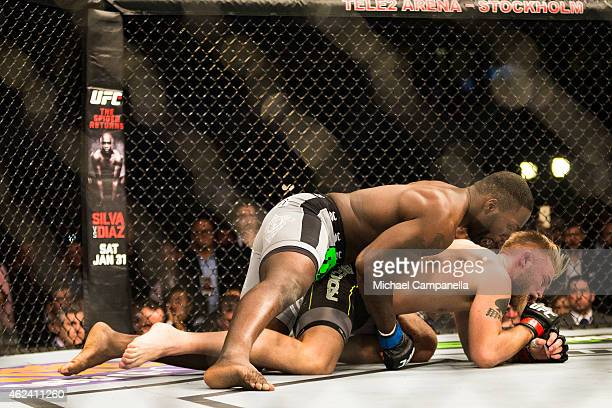 Anthony Johnson of the United States prepares to deliver the knockout blow to Alexander Gustafsson of Sweden during the UFC Fight Night event at...