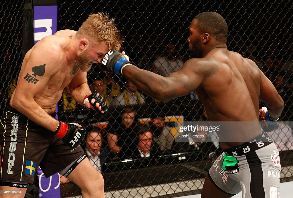 Anthony Johnson of the United States punches Alexander Gustafsson of Sweden in their light heavyweight bout during the UFC Fight Night event at the Tele2 Arena on January 24, 2015 in Stockholm, Sweden.