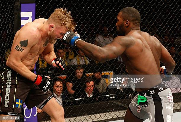 Anthony Johnson of the United States punches Alexander Gustafsson of Sweden in their light heavyweight bout during the UFC Fight Night event at the...