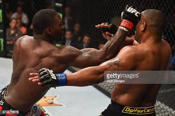 Anthony Johnson punches Daniel Cormier in their UFC light heavyweight championship bout during the UFC 187 event at the MGM Grand Garden Arena on May...