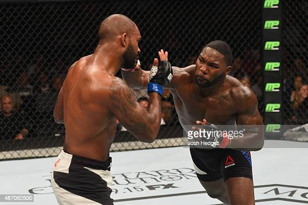 Anthony Johnson punches Jimi Manuwa in their light heavyweight bout during the UFC 191 event inside MGM Grand Garden Arena on September 5 2015 in Las...