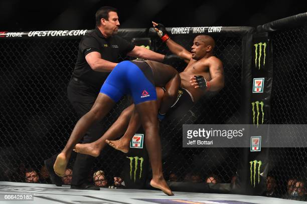 Anthony Johnson takes down Daniel Cormier in their UFC light heavyweight championship bout during the UFC 210 event at the KeyBank Center on April 8...