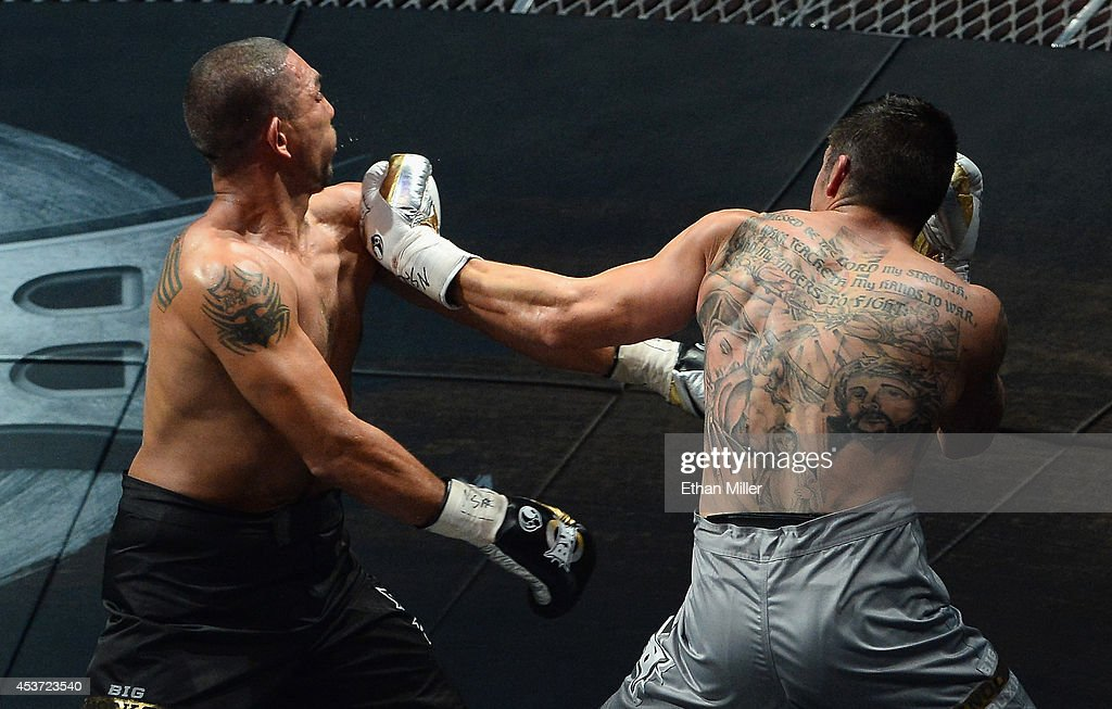 <a gi-track='captionPersonalityLinkClicked' href=/galleries/search?phrase=Anthony+Johnson+-+Mixed+Martial+Artist&family=editorial&specificpeople=12777802 ng-click='$event.stopPropagation()'>Anthony Johnson</a> (R) throws a left to the face of Dimar Ortuz during their cruiserweight title fight at the inaugural event for BKB, Big Knockout Boxing, at the Mandalay Bay Events Center on August 16, 2014 in Las Vegas, Nevada. Johnson won in a split decision.