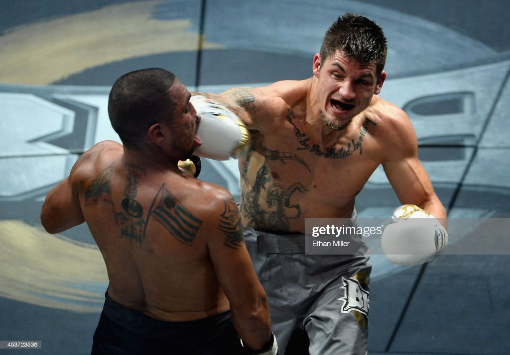 <a gi-track='captionPersonalityLinkClicked' href=/galleries/search?phrase=Anthony+Johnson+-+Mixed+Martial+Artist&family=editorial&specificpeople=12777802 ng-click='$event.stopPropagation()'>Anthony Johnson</a> (R) throws a right to the face of Dimar Ortuz during their cruiserweight title fight at the inaugural event for BKB, Big Knockout Boxing, at the Mandalay Bay Events Center on August 16, 2014 in Las Vegas, Nevada. Johnson won in a split decision.