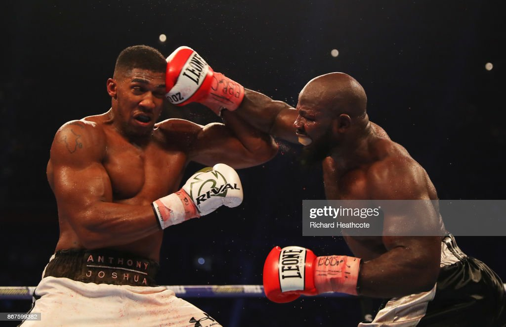 Anthony Joshua (white trunks) and Carlos Takam (black trunks) in action during their IBF, WBA & IBO Heavyweight Championship contest at Principality Stadium on October 28, 2017 in Cardiff, Wales.