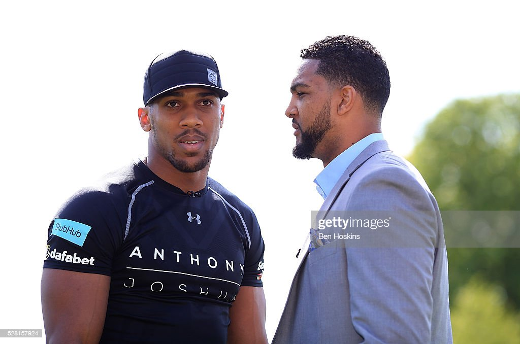 Anthony Joshua and Dominic Breazeale face off during the Anthony Joshua and Dominic Breazeale Press Conference on May 4, 2016 in London, England.