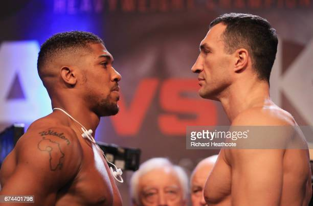Anthony Joshua and Wladimir Klitschko face each other during the weighin prior to the Heavyweight Championship contest at Wembley Arena on April 28...