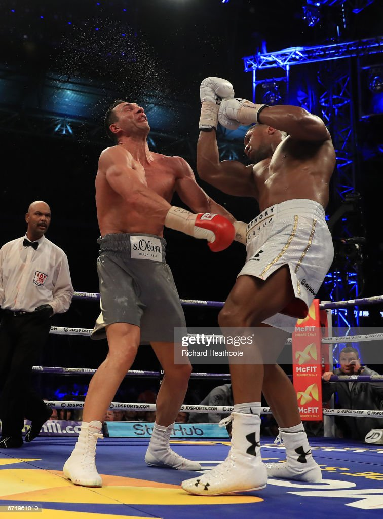 Anthony Joshua (White Shorts) and Wladimir Klitschko (Grey Shorts) in action during the IBF, WBA and IBO Heavyweight World Title bout at Wembley Stadium on April 29, 2017 in London, England.