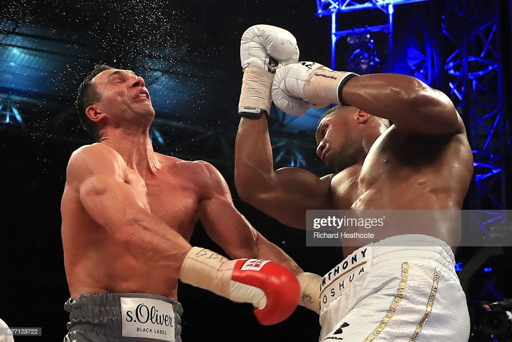 Anthony Joshua (White Shorts) and Wladimir Klitschko (Gray Shorts) in action during the IBF, WBA and IBO Heavyweight World Title bout at Wembley Stadium on April 29, 2017 in London, England.